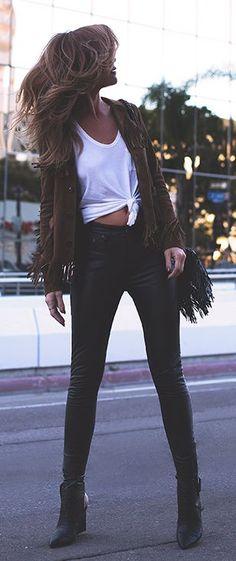 Jennifer Grace is wearing a brown suede Saint Laurent fringed jacket