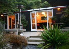 The Loveshack, Lake Rotoiti, Rotorua, N.Z. in Lake Rotoiti | Bookabach | New Zealand I like the french doors leading out to the deck