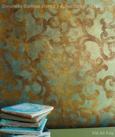 """Our Donatella Damask Stencil looks fantastic on a fabric backdrop - love it all """"distressed up""""! It's in the beautiful new WonderFaux Studio space."""