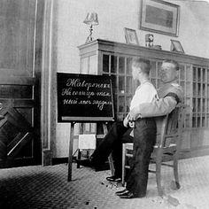Tsarevich Alexei Nikolaevich Romanov of Russia with his Russian teacher Pyotr. Nice writing!