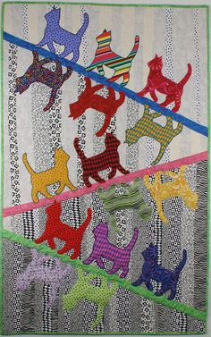 Catwalk Quilt by Linda Frost ~ Love this design! You could do so many different things with the cat colors and patterns. It would also look nice with a decorative border.