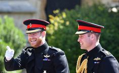 Harry smiles and points at the crowds outside the doors of the church making William laugh...