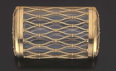 A GLASS AND GOLD CIGARETTE CASE, BY CARTIER