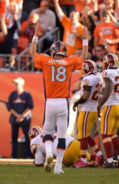 Denver Broncos quarterback Peyton Manning (18) signals for a touchdown after Denver Broncos running back Montee Ball (28) ran it in during t...   #ProFootballDenverBroncos