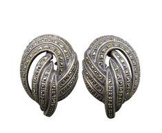 Stunning art deco design and sparkling swirls coated with rhinestones and marcasite highlight this abstract pair of Judith Jack clip earrings.