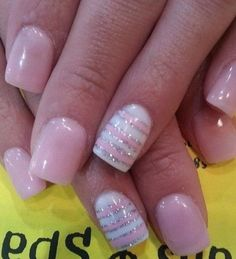 Light Pink and White Nails with Silver Glitters.