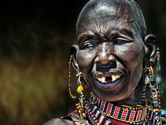 An adorned lady from Africa....Photo by Piet Flour