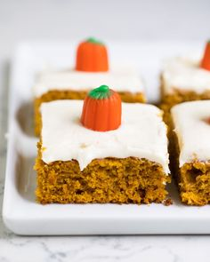 The BEST pumpkin bars with cream cheese frosting -a super soft pumpkin spiced sheet cake topped with a delicious creamy topping.