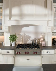 A Mantel Hood can be designed to blend with any styling theme. - Dura Supreme Cabinetry