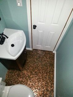 so my brother said he thought a penny floor would be cool and i totally scoffed at the idea. then i realized it would be the PERFECT budget friendly way to re-do my bathroom floor (which is about 2 seconds away from falling in Penny Boden, Small Half Bathrooms, Simple Bathroom, Bathroom Ideas, Classic Bathroom, Vanity Bathroom, Budget Bathroom, Washroom, Bath Ideas