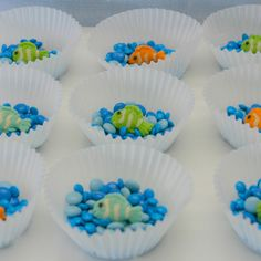 "Creative beach party favor: A ""sea"" of blue M's with a gummy fish swimming in a cupcake liner."