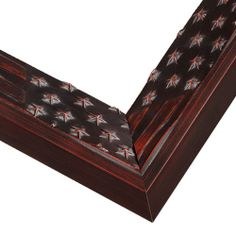 Old Glory Cherry. This wood picture frame is bold and artist designed. Featuring raised American flag detail over a mahogany finish, regardless of what you frame, it will make a classic statement of patriotism.