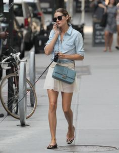 Olivia Palermo... A delicate pleated skirt and soft chambray button-down & a sky blue chain strap bag.