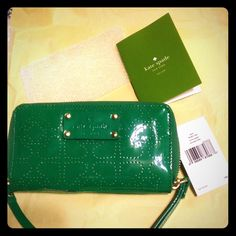 Kate Spade wallet NEW NWT Kate Spade wallet green authentic retail $168 has multiple slots for cards and full zipper awesome wallet great price ! kate spade Bags Clutches & Wristlets