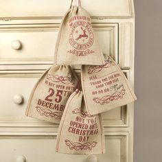 set of four jute christmas gift bags by dibor   notonthehighstreet.com