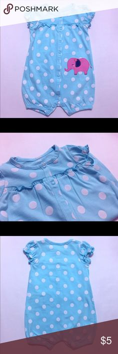 Light Blue Polka-Dot Rhomper This blue rhomper with white polka-dots features small ruffles on the sleeves and a pink elephant on the bottom left side. It buttons from the collar down to the bottom of the rhomper. Size 3-6 months. Cute yet comfortable for baby to play and get around in. Carter's One Pieces