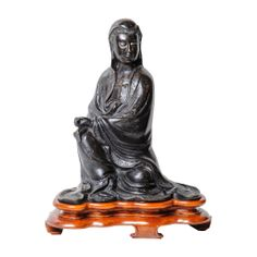 "A Mid-19th Century Qing Dynasty Bronze Seated ""Guan in""."