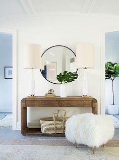 Maximize your entry with a slim console table that's perfect for a small but stylish display. If you have the space, a pair of table lamps impart a warm glow and add shape and scale.