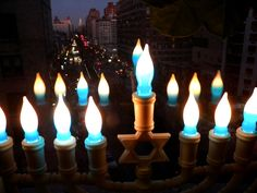 My Hanukkah menorah - Looking out the window north up Broadway from west 77th street NY, NY. The New York City metropolitan area is home to the largest Jewish community outside Israel.