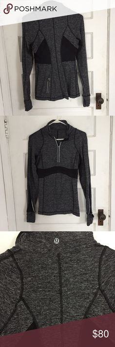 Lululemon Athletica long-sleeve 1/2 zip in grey Super soft and functional charcoal grey top from Lululemon Athletica. Thumb hole feature which reverses to fully cover the hand and keep you toasty. Great long length with a back zipper to store any essentials. Some reflective piping throughout for a really structured look. In excellent condition, looks and feels new. Size 8.   Bundle up from my closet to save! :) lululemon athletica Tops