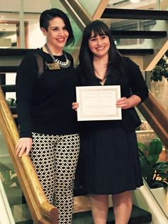 McNeice Wheeler attorney and Washington State Bar Association President-Elect, Robin Haynes, presents Gonzaga Law Student, Stephanie Faust, with a scholarship on behalf of the Washington State Association for Justice and the National Association of Women Judges.