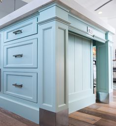 The kitchen island features v-groove on each end of the island and zinc cladding on the legs.