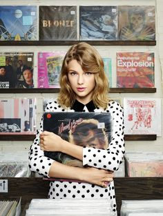 Taylor in the December 2014/January 2015 issue of Lucky Magazine wearing a Victoria Beckham dress and Eddie Borgo rings.