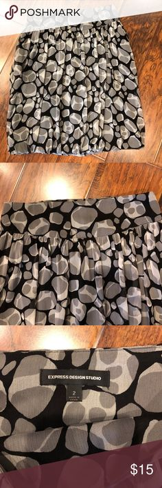 Super Cute Express Skirt Express Skirt Size 2 Amazing condition. Great for work and can be worn with a black tucked in blouse, big belt or none at all. Express Skirts