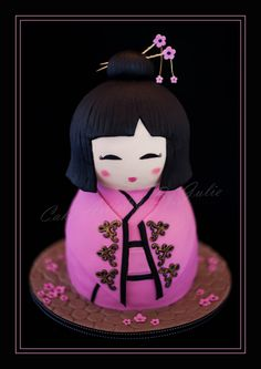 Little Kokeshi Doll - This pretty cake is my take on a Japanese Kokeshi Doll. Im rather pleased with how well she turned out, she was a lot of fun to make. Shes milk chocolate mud, filled with milk chocolate ganache.