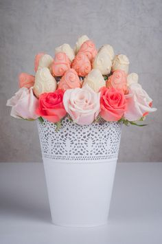 Photo about Fresh strawberry covered by pink and white chocolate with rose flowers designed as a fruit bouquet in a vase, decoration of wedding party table. Image of exotic, object, healthy - 66927070