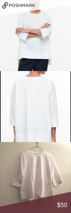 Cos White Bonded Edge Top *NWT, brand new in poly bag! SOLD OUT ONLINE! A relaxed style with boxy, oversized proportions, this soft cotton t-shirt has structured bonded edges. Clean and modern, it has 3/4 sleeves, split cuffs and a square-cut graduated hemline.  100% Cotton / Product no. 0311445007 Cos Tops