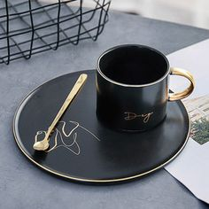 Creative black ceramic coffee mug and saucer with spoon Kitchen Jars, Cute Kitchen, Kitchen Items, Ceramic Coffee Cups, Ceramic Mugs, Coffee Mug, Couple Mugs, Cute Cups, Tea Set
