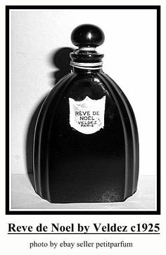 """Reve de Noel by Veldez: launched in 1925, arched black glass bottle, molded with arched vertical lines, silver foil label on front, black glass ball stopper. This bottle was also used for Extracto Mariposa by Drialys and Mimzy by De Raymond. Bottle came in two sizes: 4 1/2"""" tall, 3 3/4"""" tall.  Base is molded France. Bottle probably made by Cristalleries de Nancy. Black Perfume, Vintage Perfume Bottles, Glass Ball, Black Glass, Glass Bottles, Vintage Black, Jar, Vanity Design, Vanities"""