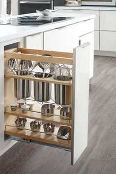 A kitchen cabinet pull-out for storage of kitchen utensils - I need this!!
