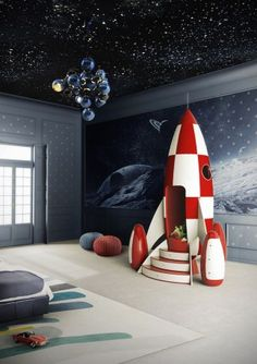 Unbelievable outer space bedroom featuring a rocket ship club house. This is taking the outer space theme to the next level.