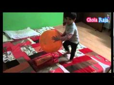 Chota Raja kid Playing with Balloon on Bed.