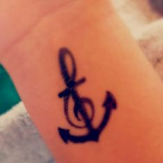 Music anchor tattoo.