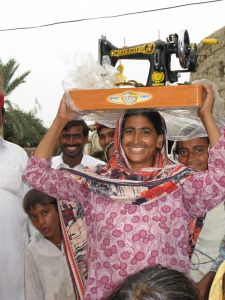 In Pakistan - dancing for joy with a new sewing machine