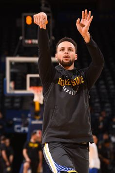 Stephen Curry of the Golden State Warriors warms up before the game against the Boston Celtics on January 27 2018 at ORACLE Arena in Oakland...