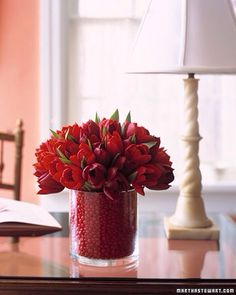 Valentine bouquet of red tulips anchored in jar of red hots.  Beautiful!
