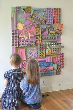 Using recycled materials, kids create a giant assemblage structure that they paint with colors they mixed themselves. A beautiful process art experience!