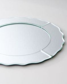 Mirrored Charger Plate at Neiman Marcus.