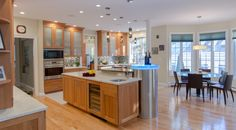Cherry Wood Kitchen - natural cherry cabinets, granite countertop, frosted glass, built in appliances, island seating.
