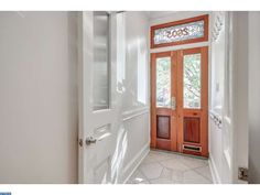 Entryway with natural wood and white door combo - 2605 BROWN STREET, PHILADELPHIA, PA