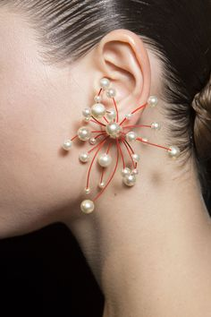 Pearl starburst earring. Christian Dior, Couture Fall 2013. Photo: IMAXtree