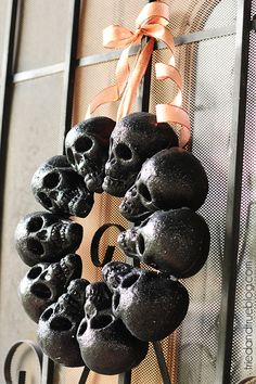 Have your front door ready to spook with this creepy wreath. For an extra bonus, put colorful lights in each skull's eyes to light things up. Get the tutorial at Tried & True.