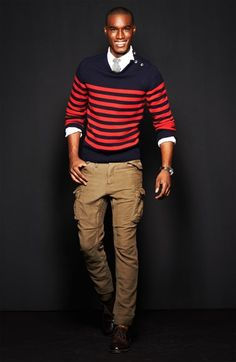 Red and navy striped sweater with buttons.