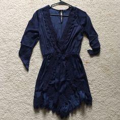 Dark blue romper Dark blue romper with embroidery Dresses