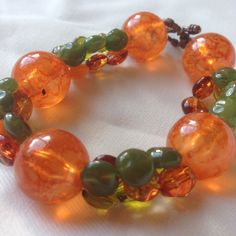 Bracelet ~ Large Beaded Bracelet ~ Green beads in three different shades ~ large marbled glass orange beads ~ toggle clasp by Nerdacious on Etsy