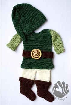 This is a pattern set written for and month old babies. It includes a slouchy, elf like hat, a Tunic top with attached sleeves, taper legged pants, boots and a belt with emblem. Crochet Baby Boots, Crochet Bebe, Crochet Baby Clothes, Cute Crochet, Crochet For Kids, Crochet Crafts, Crochet Dolls, Crochet Projects, Knit Crochet